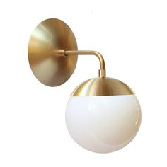 "Cedar & Moss Alto Sconce 6"". Shown in brass with opal glass."