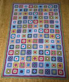 """Harmony Blanket, free pattern by Lucy of Attic 24. Very comprehensive, step-by-step photo tutorial, with join-as-you-go. Worked in 15 colors of Stylecraft Special DK. (The """"Harmony"""" yarn pack is available from the Wool Warehouse including the printed pattern; worldwide shipment from U.K. Link on…"""