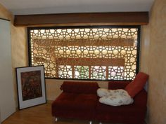 Claustra de séparartion d'une mezzanine doublée d'une feuille de verre