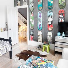 Cool boys' bedroom with skateboard theme. Give your child the chance to think about how he or she would like to decorate the room – they have to sleep there after all. Here the owners worked with their son to create a room he loves. The cool skateboard wallpaper will still be cool when he's grown up, and the more adult design touches, including the limewashed floor and simple accessories will ensure that nothing dates too quickly.