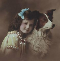 Tinted photograph of little girl and dog.
