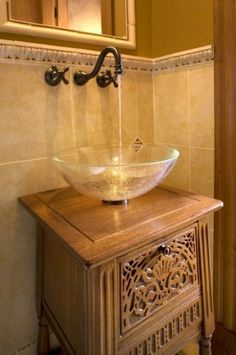 by Haddad Hakansson LLC   For a tiny bathroom: Use a vessel sink. The counter space of this tiny cabinet would have been completely taken up by a standard type of sink. Using a bowl-shaped vessel sink frees up almost the entire top of this cabinet as usable counter space for toiletries. Using a wall-mounted faucet also keeps the counter space free.