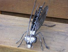Insect Metal Sculpture Flying Bug Garden Art Yard Art Found Objects. $58.75, via Etsy.