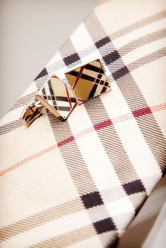 Burberry cufflink and tie. I need this in my closet