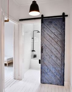 I the rustic, white-painted wooden floor that covers all the rooms, even the bathroom. The old barn door that leads into the bathroom is so pretty and adds some roughness to this clean, white house Bathroom. WABI SABI Scandinavia - Design, Art and DIY. The Doors, Sliding Doors, Front Doors, Entry Doors, Sliding Cupboard, Hall Cupboard, Barn Door Pantry, Diy Barn Door, Diy Door