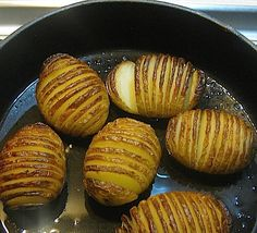 Sliced baked potatoes, add some bacon fat to skillet and thin slice of onion into each slit