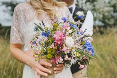 High summer, just picked wedding bouquet using British flowers and a few home grown treats. This rustic wild brides bouquet contains cornflowers, love-in-a-mist, fever few, larkspur, mint, alchemilla and old fashioned gyp. www.wildandwondrousflowers.co.uk Photo by Wedding Vintage http://www.weddingsvintage.com