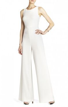 $175.00 No hassle shipping and returns. Receive free shipping and free returns on all bridal and bridesmaid styles.   Clean lines and a minimalist construction give this jumpsuit unique, high-style appeal. Round neck. Sleeveless.Cutouts at sides. Wide-leg.Concealed center back zipper with hook-and-eye closure.Crepe: Polyester, Rayon, Spandex. Crepe de Chine: Polyester.Dry Clean.Imported.