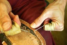 Hand sewing leather shoes