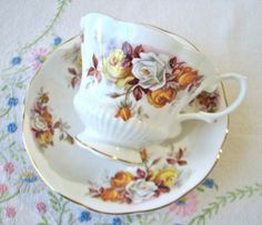 Royal Albert bone china tea set in Lenora floral pattern with ridges, scallops, and gold trim