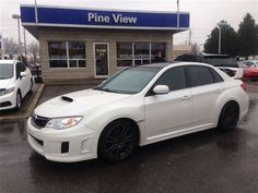 1 of my family's 2 vehicles is a used 2013 Subaru WRX STI. It costs $35,388 plus taxes, which in total costs $39,988. We made a down payment of $17,500 and make monthly payments of $300. Monthly repairs and upkeep cost roughly $100.