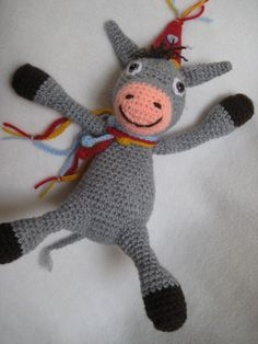 Amigurumi crochet --- PDF PATTERN --- Pingo the Donkey. Now this is a real party animal ! :-) Pingo will never go to any party without his garland and party hat. The pattern is worked in continuous rounds. Pingo is crocheted from the bottom up, body and head are 1 part. Size will be approximately 25 cm (9.84) tall, in sitting position, crocheted from acrylic yarn (8 ply / dk), with hooksize 4 mm. (G) If you wish to make a taller or smaller version of Pingo, you can just use thicker or…