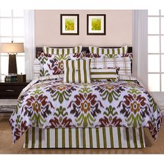 A mix of modern floral, stripes, and plaid energizes this contemporary bed-in-a-bag. The set has everything you need to put together a designer-style bed, including a reversible comforter, shams, bedskirt, sheet set, and accent pillows.