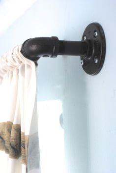 These DIY industrial style pipe curtain rods are a cinch to make, and way cheaper than the West Elm version. Get the tutorial at www.makingl...