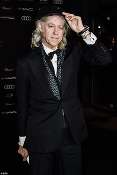 Dapper: Bob Geldof looked sharp in a black tuxedo as he joined dazzling heiresses Victoria and Paulina Swarovski at the AIDS foundation's Opera Gala in Berlin on Saturday Black Bow Tie, Black Tuxedo, Brenda Ann Spencer, The Boomtown Rats, Bob Geldof, Live Aid, Tears For Fears, Pink Floyd, Will Smith