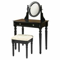 "The perfect spot for your morning routine and evening prep, this 1-drawer vanity showcases detailed spindle legs and an attached oval-shaped mirror. This lovely set includes a padded seat with white upholstery.   Product: Vanity and benchConstruction Material: Rubber wood, MDF, mirrored glass, foam and fabric Color: Black and whiteFeatures:  Intricately detailed spindle legsLarge drawer Dimensions: 49"" H x 32"" W x 18.3"" D (vanity)"