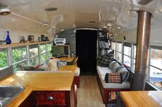 Living area of a bus. Cool blog about living in the bus...with kids....natural childbirth and much more.