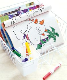Use a dish drying rack to keep coloring books and art supplies organized. Stack the books, like plates, between the prongs. Store markers, crayons, and pencils in the utensil caddy.