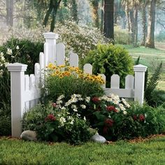 Corner flower garden - I love this little fence area this would be so cute at a mailbox or entry to a property.