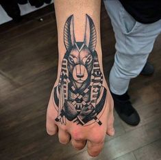 People often opt for God tattoos and many tattoos are inspired by Gods of various cultures. Anubis tattoos are popular because of his importance in Ancient Egyptian Culture. God Tattoos, Future Tattoos, Body Art Tattoos, Small Tattoos, Anubis Tattoo, Horus Tattoo, Neck Tattoo For Guys, Hand Tattoos For Guys, Tattoo Design Drawings