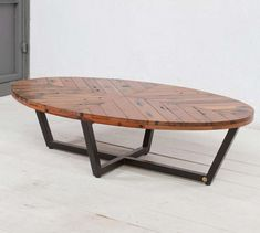 Rustic Oval coffee table, with herringbone design on top.  More often than not, this oval shape is easiest to work with, as it gives more of the illusion of space and does in fact use up less real estate.