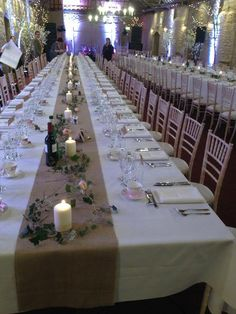 from Fridays wedding here - lovely table runners of hessian and simple ivy and single roses along the centre...