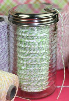 Dollar store sugar shaker as a twine or yarn dispenser