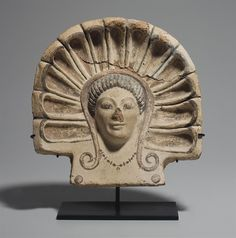 AN ETRUSCAN TERRACOTTA ANTEFIX -  CIRCA EARLY 5TH CENTURY B.C.  | Christie's