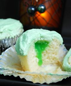 I made for H's Mad Science party and f… Slime-filled cupcakes (Baking Bites); I made for H's Mad Science party and filled with lemon curd tinted green. Halloween Party Snacks, Fete Halloween, Halloween Goodies, Halloween Cupcakes, Baking Cupcakes, Cupcake Recipes, Cupcake Cakes, Dessert Recipes, Desserts