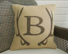 We could do something like this with your brand and put it on pillows for the lounge, napkins at the bar etc.   Deer Antler Monogram Pillow  - Burlap Pillow - Antler Decor - Burlap Monogram Pillow - Fall Decor