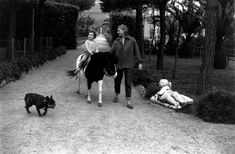 0 Ingrid BERGMAN with her daughter, Isabella ROSSELLINI, riding a pony and her dog at their home - italy 1956