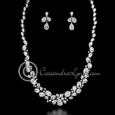 Oval, teardrop and round CZ jewels are set in a silver textured setting. Earrings are approximately 1 inch long, post backs, the necklace is 16 inches with a locking clasp. This item is a special orde