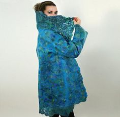 "This beautiful coat ""PEACOCK"" was created by wet nuno-felting. Made from Merino wool, Habotai silk, wool, mohair and silk yarns, tencel fibers."