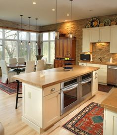 Island Stoves and Ovens   Kitchen island with two side by side built-in ovens