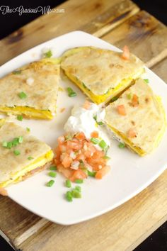Breakfast Quesadillas Recipe - an easy and quick breakfast recipe with eggs, cheese, and bacon. So delicious and great for kids! From TheGraciousWife.com