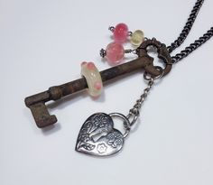 Antique skeleton key with a free-moving lampwork bead.
