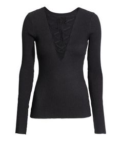 H&M  Ribbed top with lacing 149 AED Long-sleeved fitted top in a soft rib knit with a deep V-neck and lacing at the front.