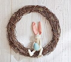 I bet I could make something similar: the wreath is $5 and find a bunny or something and hot glue it. Voila! $30 cheaper!
