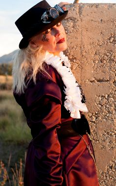Steam punk with hat, glasses, and gorgeous dusk lighting. Against a cement block. My purple coat looks red in the dusky lighting. Springville, Utah August 2013