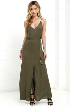 Take a deep breath and enjoy an effortless day spent in the Fresh Air Olive Green Maxi Dress! Soft woven fabric drapes from adjustable spaghetti straps into a V neckline and low sloping back. Tasseled waist tie threads through belt loops above a maxi skirt with center slit. Hidden back zipper with clasp.