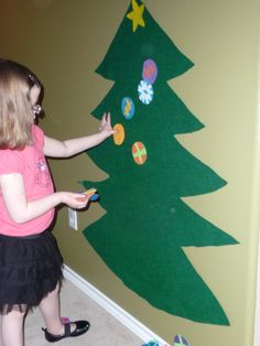 This Frugal Kids Christmas Craft is so cute! Pin the star on the tree with this easy Christmas craft.