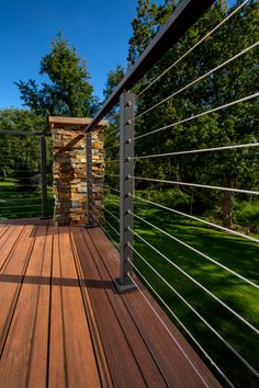 Powder-coated black posts are extremely popular for cable railing systems. These black posts are connected to brick pillars, creating an inviting space. Metal Deck Railing, Patio Railing, Balcony Railing Design, Deck With Pergola, Outdoor Pergola, Patio Roof, Cable Railing, Pergola Kits, Metal Roof