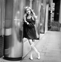 Actress and model Maddy Smith a.k.a. Madeline Smith aged 20 photographed in London wearing a black dress and white knee in 1969