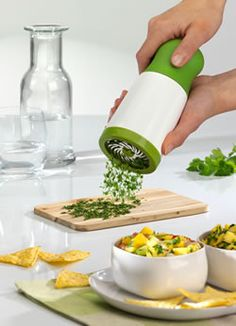 Herb Mill. Easily cut up herbs instead of chopping by hand. Available through this link at Amazon for about $19. Others available through AliExpress for cheaper, but different brands/styles. - Nessa