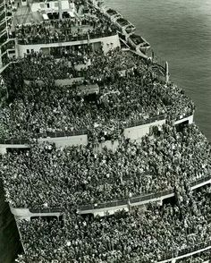 The Queen Mary.  End of WWII. New York. Returning American troops. My Daddy was on this ship, returning! ❤