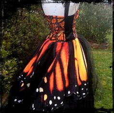 Lady Moon Designs. https://www.facebook.com/Lady-Moon-Designs-91806628214/  One of a Kind Monarch Butterfly Wing Wedding or Ball Gown for paras2npat. Butterfly wings long at the back and shorter at the front. Butterfly wing bodice panels. Short and full skirt underneath coming from the high waist.