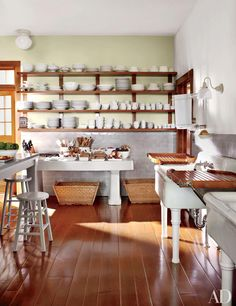 The wainscot in Martha Stewart's Maine kitchen is made of vintage Pewabic tiles; the antique fishmonger's table against the far wall is from Ann-Morris.