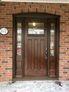 """Elegant & charming #AmberwoodDoors #handmadecustom 1/4"""" sawn white oak single #door with 2 sidelights; beautiful custom beveled lead glass; rich Brown Cherry stain; sturdy Rectangular Full Length lockset @emtekassaabloy in lovely Medium Bronze Patina #IHaveThisThingWithDoors Call or come into Amberwood's outstanding showroom today and discover your dream doors! 416-213-8007 #AmberwoodDoors proudly ships internationally! Call today for shipping details! 1-800-861-3591"""