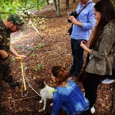 A white truffle hunter and his specially trained dog lead a foraging excursion in the hills of Emilia Romagna.