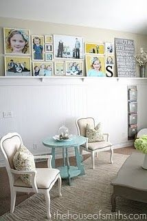 love it all. note: valspar crystal aqua ? paint color. Zebra rug, bead board wall, picture gallery. chairs.